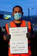 Self portrait outside Amazon Fulfillment Center Man 3 Near Bolton. At the end of a 10.5 hour night shift. Holding paper showing two impacts of  this COVID lockdown. Previously and still working as a selfemployed photographer fror 17 years. Worked at Amazon for 4 weeks.