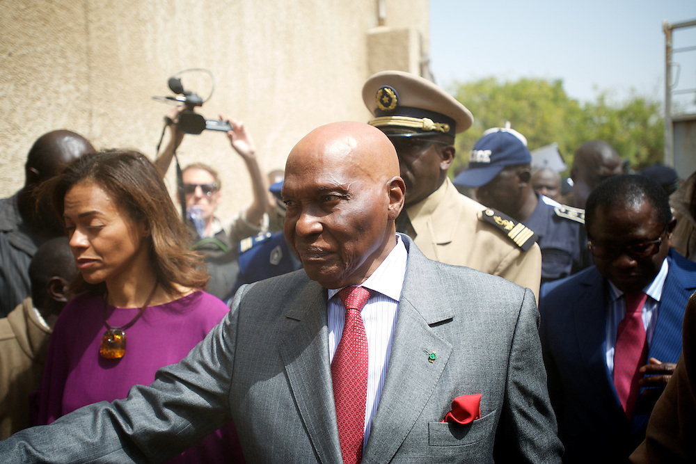 February 26, 2012 - Dakar, Senegal: Senegal's president and candidate, Abdoulaye Wade, arrives to cast his vote at a polling station in Franco-Arab School in Point E area of Dakar. Hundreds of people queueing for voting insulted and heckled Wade, accusing the head of state of disrespect for the country's constitution when running for a third mandate. (Paulo Nunes dos Santos/Polaris)