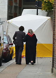© Licensed to London News Pictures. 26/10/2012. Fulham, UK  Local residents walk down the street where the murder took place.  Police have launched a murder investigation following the stabbing of a man in Fulham. Officers were called at approx. 18:55hrs on Thursday 25 October to Fulham High Street following reports of an assault. London Ambulance Service and London's Air Ambulance also attended and discovered a man, aged 65, suffering from stab wounds. He was pronounced dead at the scene . Photo credit : Stephen Simpson/LNP