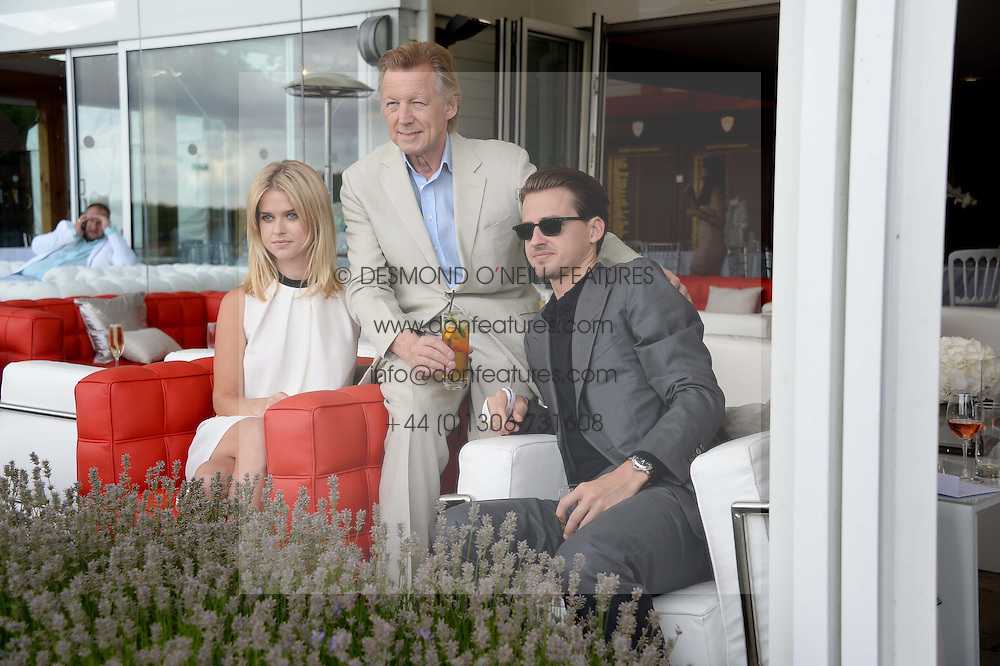 Left to right, ALICE EVE, JOHN STEPHEN and JACK EVE at the Audi International Polo at Guards Polo Windsor Great Park, Egham, Surrey on 28th July 2013.