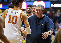 Feb 9, 2019; Morgantown, WV, USA; West Virginia Mountaineers head coach Bob Huggins talks with Texas Longhorns forward Jaxson Hayes (10) after the game at WVU Coliseum. Mandatory Credit: Ben Queen-USA TODAY Sports