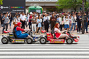 Tourists riding go carts dressed as characters from the Super Mario carting game in Tokyo, Japan. Sunday May 7th 2017.