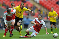 Burton Albion's Adam McGurk (c) is fouled by Fleetwood Town's  Antoni Sarcevic (l) and Fleetwood Town's  Alan Goodall (r) Skybet football league two play off final match , Burton Albion v Fleetwood Town at Wembley Stadium in  London on Monday 26th May 2014.<br /> pic by John Patrick Fletcher, Andrew Orchard sports photography.