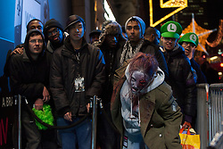 © licensed to London News Pictures. London, UK 29/11/2012. People waiting at the queue for the launch of Nintendo's latest gaming console, Wii U at HMV Store in Oxford Street, London. Photo credit: Tolga Akmen/LNP