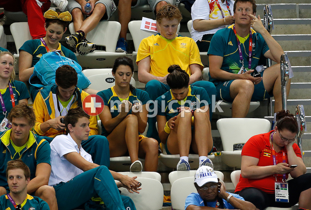 Blair Evans (C L) of Australia and her teammate Stephanie Rice (C R) polish their fingernails while attending the heats session at the Swimming competition held at the Aquatics Center during the London 2012 Olympic Games in London, Great Britain, Friday, Aug. 3, 2012. (Photo by Patrick B. Kraemer / MAGICPBK)