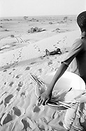 NIGER. Bouza. 21/01/1987:Collecting cattle dung for fuel.