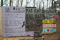 Wendover, UK. 20th February, 2021. Signs referring to bats are pictured on the exterior of the Wendover Active Resistance Camp which is occupied by activists opposed to the HS2 high-speed rail link from HS2 Rebellion. A chain of such camps has been built by environmental activists along the planned route of the rail project from Euston in London to Birmingham.