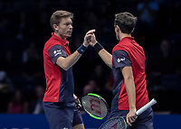 Tennis - 2019 Nitto ATP Finals at The O2 - Day Eight<br /> <br /> Doubles Final : Pierre-Hugues Herbert (FRA) & Nicolas Mahut (FRA) Vs. Raven Klaasen (RSA) & Michael Venus (NZL)<br /> <br /> Nicolas Mahut (FRA) and Pierre-Hugues Herbert (FRA) between points congratulate each other<br /> <br /> COLORSPORT/DANIEL BEARHAM