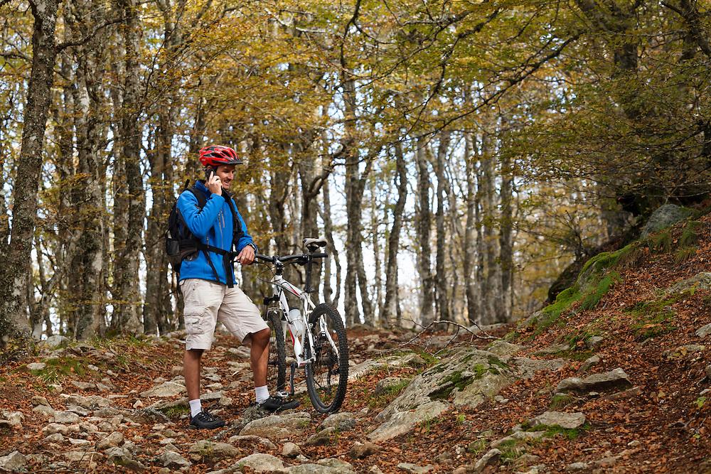 Mountain biker on the phone