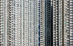 Facade of dense urban high-rise apartment buildings in Shek Kip Mei in Kowloon, Hong Kong, China.