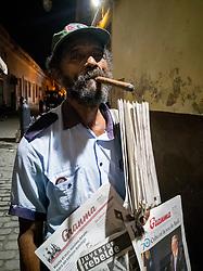 Old man selling newspapers in Havana, Cuba. Havana vieja, street. Cigar.