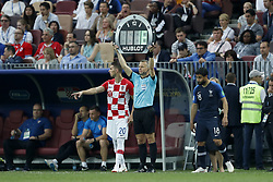 (L-R) Marko Pjaca of Croatia, 4th official Bjorn Kuipers, Nabil Fekir of France during the 2018 FIFA World Cup Russia Final match between France and Croatia at the Luzhniki Stadium on July 15, 2018 in Moscow, Russia