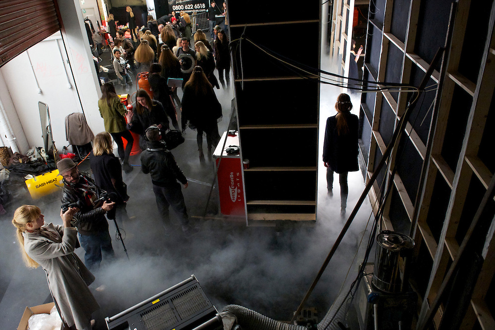 Models emerge through the fog from backstage at the Charles Anastase autumn 2011 collection onto the catwalk at the Old Sorting Office in London on 19 February 2011.
