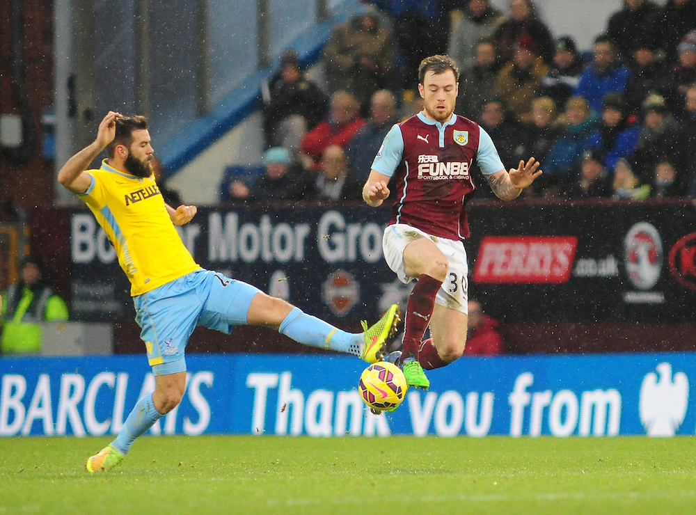 Burnley's Ashley Barnes vies for possession with Crystal Palace's Joe Ledley<br /> <br /> Photographer Chris Vaughan/CameraSport<br /> <br /> Football - Barclays Premiership - Burnley v Crystal Palace - Saturday 17th January 2015 - Turf Moor - Burnley<br /> <br /> © CameraSport - 43 Linden Ave. Countesthorpe. Leicester. England. LE8 5PG - Tel: +44 (0) 116 277 4147 - admin@camerasport.com - www.camerasport.com