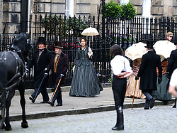 """Moray Place in Edinburgh's Georgian old town was turned into 19th century London for Julian Fellowes' new ITV show """"Belgravia"""".<br /> <br /> Pictured: Tamsin Greig (striped dress) during a take<br /> <br /> Alex Todd 