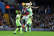 Jordan Ayew of Aston Villa © jumps for a header with Nicolas Otamendi of Manchester city. Barclays Premier league match, Aston Villa v Manchester city at Villa Park in Birmingham, Midlands  on Sunday 8th November 2015.<br /> pic by  Andrew Orchard, Andrew Orchard sports photography.