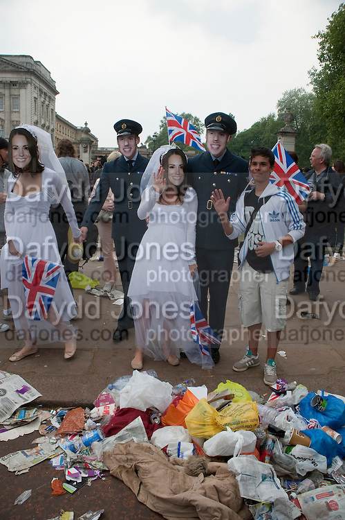 ROYAL MASKS AND LITTER, The Royal Wedding of Prince William and  Catherine Middleton. Scenes around Buckingham Palace and the Mall.   London. 29 April 2011. , -DO NOT ARCHIVE-© Copyright Photograph by Dafydd Jones. 248 Clapham Rd. London SW9 0PZ. Tel 0207 820 0771. www.dafjones.com.