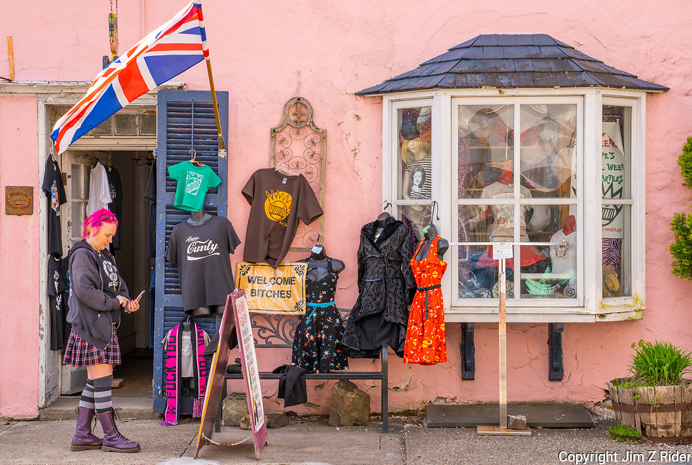 A shopkeeper sets up her display outside of God Save The Qweens in New Hope, PA, a regional tourist destination along the Delaware River with a wide variety of unique shops, galleries, bars, and restaurants.