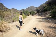 woman and her dog at Pratt Trail, Ojai, Ventura County, California, USA