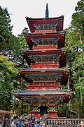 """5 story pagoda. Toshogu Shrine is the final resting place of Tokugawa Ieyasu, the founder of the Tokugawa Shogunate that ruled Japan for over 250 years until 1868. Ieyasu is enshrined at Toshogu as the deity Tosho Daigongen, """"Great Deity of the East Shining Light"""". Initially a relatively simple mausoleum, Toshogu was enlarged into the spectacular complex seen today by Ieyasu's grandson Iemitsu during the first half of the 1600s. The lavishly decorated shrine complex consists of more than a dozen buildings set in a beautiful forest. Countless wood carvings and large amounts of gold leaf were used to decorate the buildings in a way not seen elsewhere in Japan. Toshogu contains both Shinto and Buddhist elements, as was common until the Meiji Period when Shinto was deliberately separated from Buddhism. Toshogu is part of Shrines and Temples of Nikko UNESCO World Heritage site."""