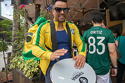 July 2, 2018 - FL, USA - Brazilian fan Almir Silva plays drums as he watches the 2018 FIFA World Cup Round of 16 knockout stage featuring Brazil versus Mexico outside Vares in Brickell on Monday, July 2, 2018. (Credit Image: © Sam Navarro/TNS via ZUMA Wire)