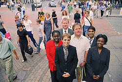 Multiracial group of adults standing together in street,