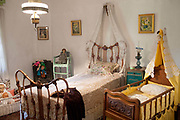 Museum exhibit of a bedroom in a traditional Argentinian estancia (farm) Lujan, Argentina.