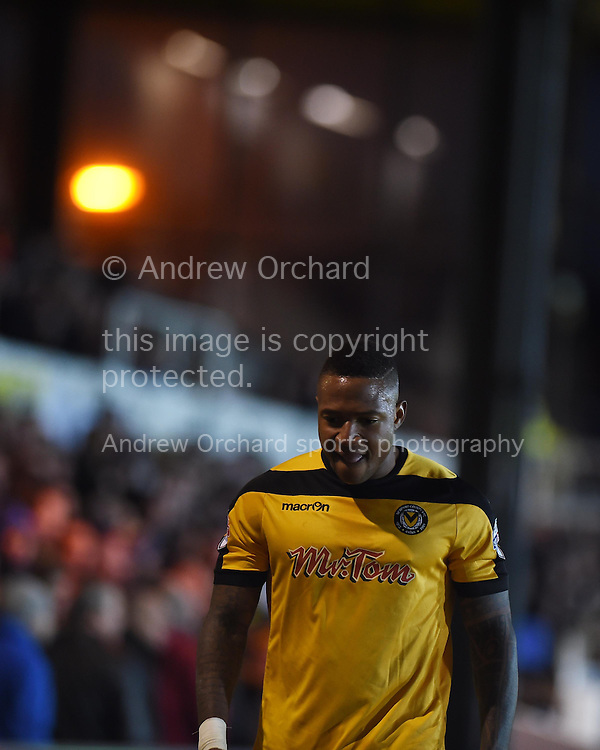 Newport county's Aaron O'Connor walks off after being sent off. Skybet football league two match, Newport county v Stevenage at Rodney Parade in Newport, South Wales on Saturday 13th December 2014<br /> pic by Andrew Orchard, Andrew Orchard sports photography.