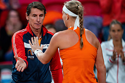 Kiki Bertens celebrate with Coach Paul Haarhuis in the Fed Cup qualifier against Belarus in Sportcampus Zuiderpark, The Hague, Netherlands