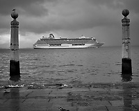 Cruse ship leaving Lisbon on a rainy day. Afternoon walkabout in Lisbon. Image taken with a Leica CL camera and 23 mm f/2 lens.