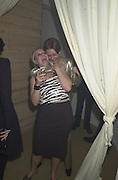 Louisa Schofield ( B&wtop) and Helen Jackson ( silver). Nicholson Estates 100 Westminster Bridge Rd. party. 1 Feb 2001.© Copyright Photograph by Dafydd Jones 66 Stockwell Park Rd. London SW9 0DA Tel 020 7733 0108 www.dafjones.com