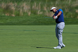 May 16, 2019 - Bethpage, New York, United States - Tiger Woods hits a fairway shot on the 18th hole during the first round of the 101st PGA Championship at Bethpage Black. (Credit Image: © Debby Wong/ZUMA Wire)