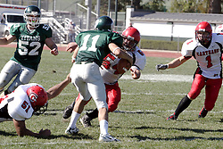 07 October 2006: Nick Panno is flushed by Chris Coker (51) and Mark Januszewski (54). The Titans of Illinois Wesleyan University started off strong with a touchdown on the 2nd play from scrimmage in the game.  The Titans led most of the way, but failed to maintain the lead in the 4th quarter giving up the decision of this CCIW conference game to the Red Men of Carthage by a score of 31 - 28. Action was at Wilder Field on the campus of Illinois Wesleyan University in Bloomington Illinois.<br />