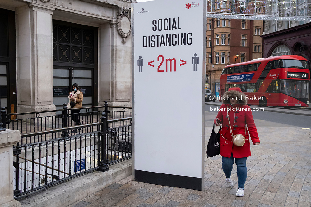 In advance of a re-opening of businesses and before a change to a Tier 2 for London during the second wave of the Coronavirus pandemic, shoppers pass through Oxford Street, on 30th November 2020, in London, England. Retailers will once again be open for Christmas business on 3rd December.