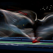 A blur of motion as Jun Zhu, China, (left) competes with Byungchul Choi, Korea, in the Men's Foil Individual event during the Fencing competition at ExCel South Hall during the London 2012 Olympic games. London, UK. 31st July 2012. Photo Tim Clayton