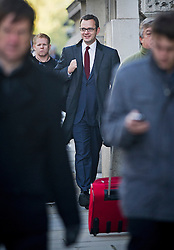 © London News Pictures. 13/11/2013. London, UK. Former editor of the News of the World  ANDREW COULSON (centre) arriving at The Old Bailey in London where he is currently facing trial over allegations of  phone hacking and and payments to officials at News International. Photo credit: Ben Cawthra/LNP