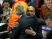 02.10.2013 Manchester, England. Bayern Munich Manager Joesp Guardiola  and Manchester City Manager Mario Pellegrini  embarce before the Group D UEFA Champions League game between, Manchester City and Bayern Munich from the Etihad Stadium.