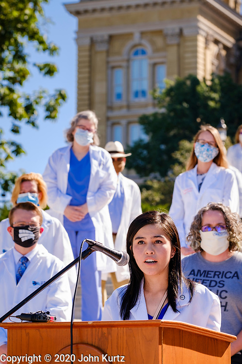 01 AUGUST 2020 - DES MOINES, IOWA: Dr. ROSANNA ROSA speaks at the Iowa State Capitol Saturday. About 50 doctors, medical professionals, and public health professionals from across Iowa came to the State Capitol to demand that Iowa Governor Kim Reynolds impose a mask mandate to control the spread of the coronavirus (SARS-CoV-2). Despite the continued spread of the coronavirus and rapidly increasing infection rate for COVID-19, the Governor has refused to impose a mask mandate or close businesses. For the week ending Saturday, Aug. 1, Iowa reported new 2,736 new cases of COVID-19.             PHOTO BY JACK KURTZ