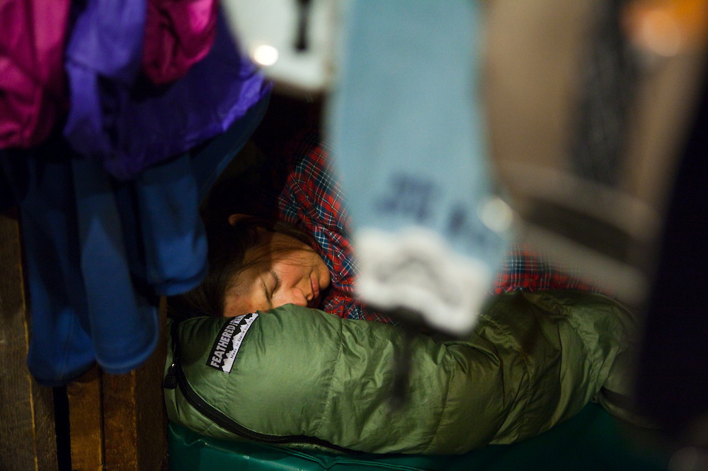 Meaghan Daly sleeps in her bunk at the backcountry Ridgway Hut, San Juan Mountains, Colorado.