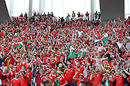 Wales football fans look on from the stands. Euro 2016, Wales v Slovakia at Matmut Atlantique , Nouveau Stade de Bordeaux  in Bordeaux, France on Saturday 11th June 2016, pic by  Andrew Orchard,