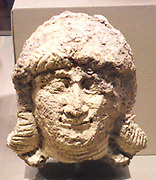 Head of a female, Old Babylonian. ca. 2000–1600 B.C. from Southern Mesopotamia. Ceramic