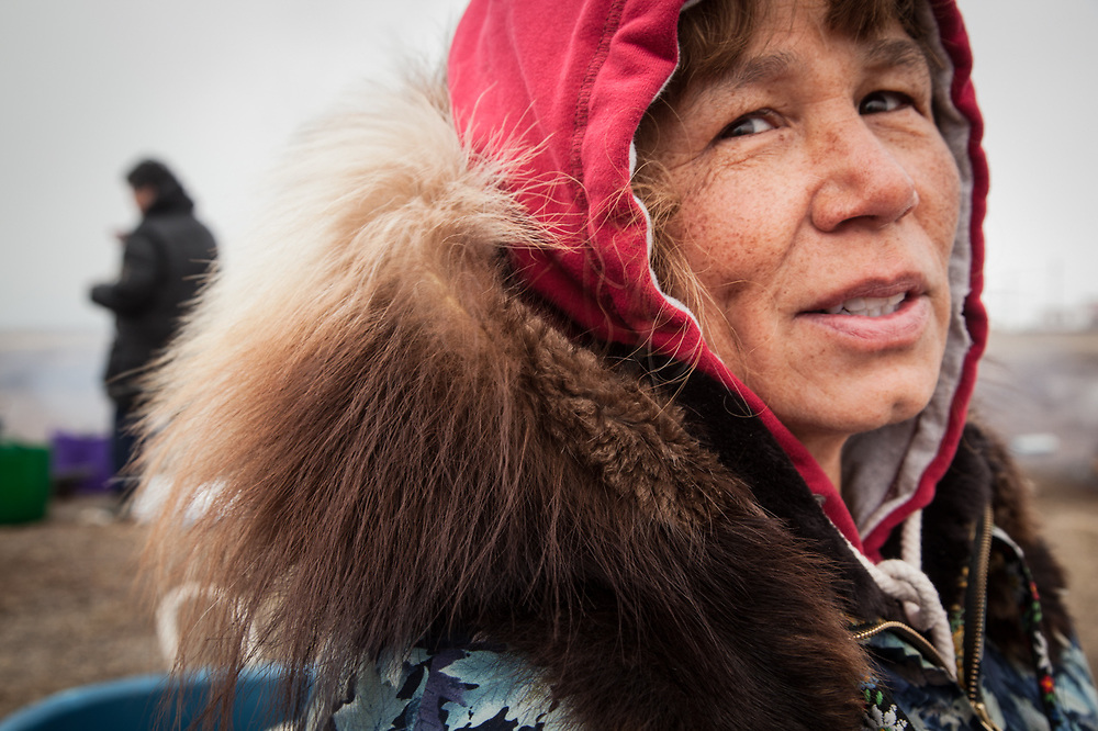 Doris Kubanyi, a resident of Fairbanks, visits her mother's village during Unagsiksiksauq (Clan Boat Celebration), Qagruq (Whaling Feast), Point Hope, The Purchase Centennial Poject