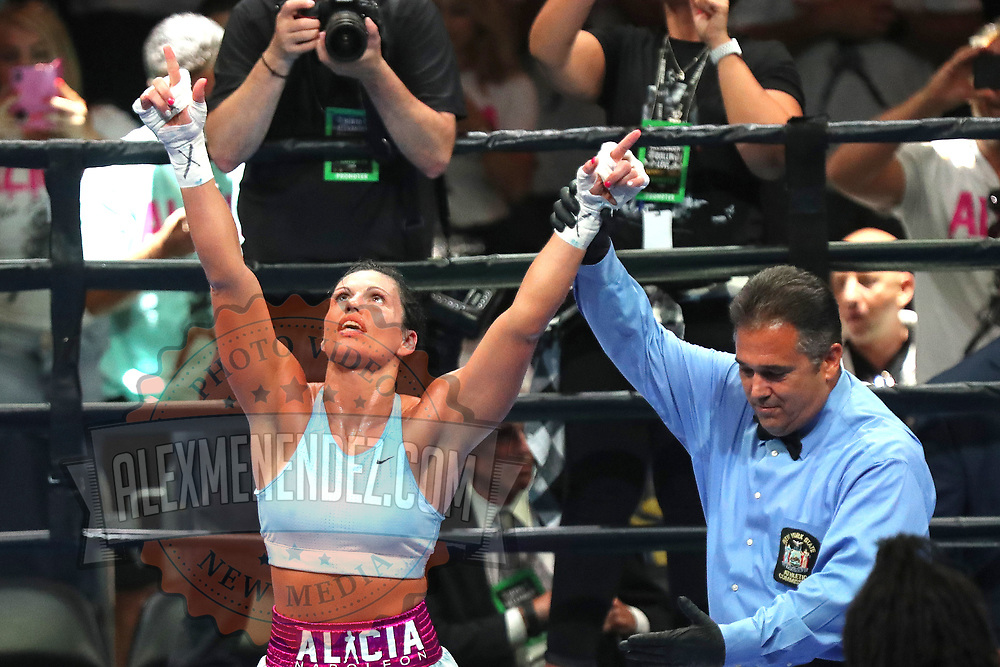 Alicia Napoleon from Brooklyn, New York celebrates her unanimous decision victory over Hannah Rankin of Scotland during a Premier Boxing Champions fight on Saturday, August 4, 2018 at the Nassau Veterans Memorial Coliseum in Uniondale, New York.  (Alex Menendez via AP)