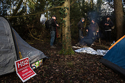 Denham, UK. 3 February, 2020. Environmental activists from Save Colne Valley and Extinction Rebellion talk in a camp in Denham Country Park where they are seeking to prevent works for the HS2 high-speed rail link including the felling of 200 trees and the construction of a Bailey bridge, compounds, fencing and a parking area. One side of the river bank lies within a wetland nature reserve forming part of a Site of Metropolitan Importance for Nature Conservation (SMI). In spite of a substantial police presence, HS2 were not able to proceed with the work.
