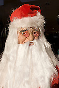 A Santa Christmas party costume is displayed in the front window of a fancy dress shop in Goven Hill, south Glasgow.