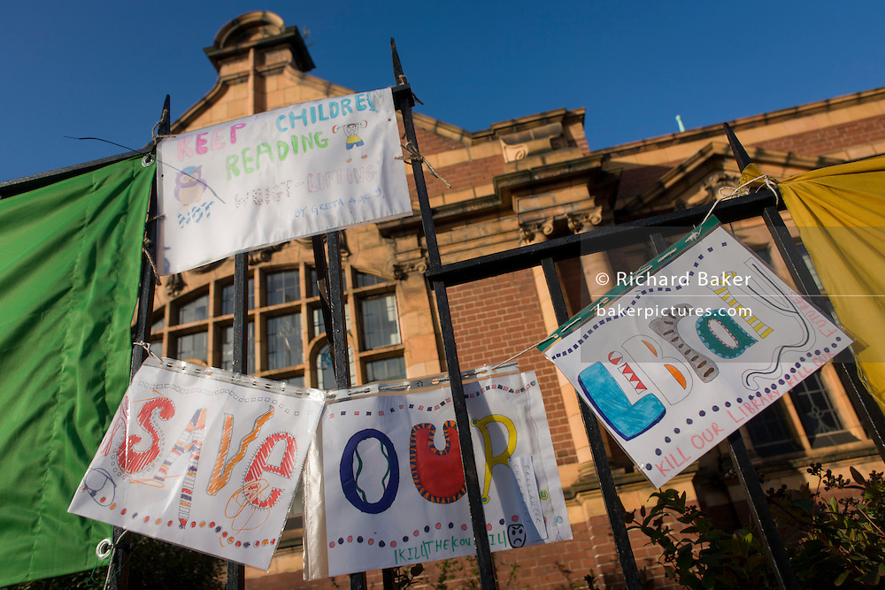 Childrens' protest banners outside Carnegie Library in Herne Hill, south London while occupiers remain inside the premises on day 6 of its occupation, 5th April 2016. The angry local community in the south London borough have occupied their important resource for learning and social hub for the weekend. After a long campaign by locals, Lambeth have gone ahead and closed the library's doors for the last time because they say, cuts to their budget mean millions must be saved.