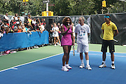 l to r: Serena Williams, John McEnroe and Raphael Nadal at the Nike Youth Tennis  Challenge held at The Nike -Built regulation Tennis Court  on West 23rd Street & Broadway in New York  City . ..Hundreds of tennis fans and youth form New York  Parks and Rec. Athlethes for Charity, and Mentoring USA are treating to tips and guidance from Tennis Pros Roger Federer, Rafael Nadal and Serena Williams...