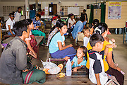 20 MAY 2013 - MAE KASA, TAK, THAILAND:  Burmese patients in the outpatient waiting room at the SMRU clinic in Mae Kasa, Thailand. Every patient who comes into the clinic is tested for malaria. The clinic is less than 50 meters from the Thai-Burma border and sees only Burmese patients. Thais go to Thai government hospitals. Health professionals are seeing increasing evidence of malaria resistant to artemisinin coming out of the jungles of Southeast Asia. Artemisinin has been the first choice for battling malaria in Southeast Asia for 20 years. In recent years though,  health care workers in Cambodia and Myanmar (Burma) are seeing signs that the malaria parasite is becoming resistant to artemisinin. Scientists who study malaria are concerned that history could repeat itself because chloroquine, an effective malaria treatment until the 1990s, first lost its effectiveness in Cambodia and Burma before spreading to Africa, which led to a spike in deaths there. Doctors at the Shaklo Malaria Research Unit (SMRU), which studies malaria along the Thai Burma border, are worried that artemisinin resistance is growing at a rapid pace. Dr. Aung Pyae Phyo, a Burmese physician at a SMRU clinic just a few meters from the Burmese border, said that in 2009, 90 percent of patients were cured with artemisinin, but in 2010, it dropped to about 70 percent and is now between 55 and 60 percent. He said the concern is that as it becomes more difficult to clear the parasite from a patient, progress that has been made in combating malaria will be lost and the disease could make a comeback in Southeast Asia.    PHOTO BY JACK KURTZ
