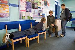 Teenage boys; taking a break; chatting in the school common room,