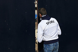 19 March 2017 - Premier League - Tottenham Hotspur v Southampton - A fan peers through a gap in the fence to admire the construction work on the new stadium - Photo: Marc Atkins / Offside.